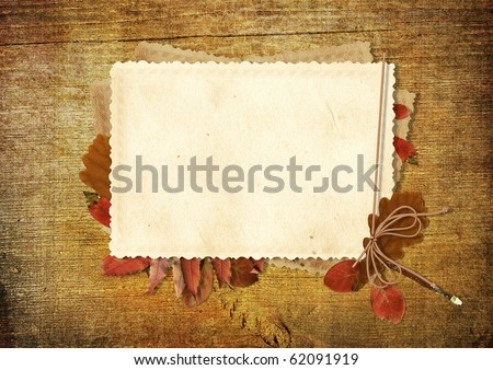 vintage card on wooden background - stock photo