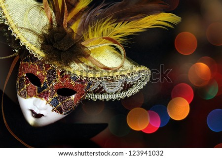 Vintage carnival mask in front of lights background - stock photo