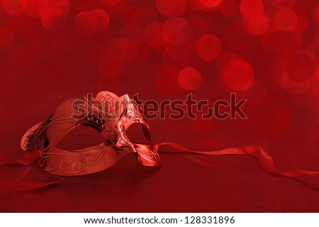 Vintage carnival mask in front of red lights background - stock photo