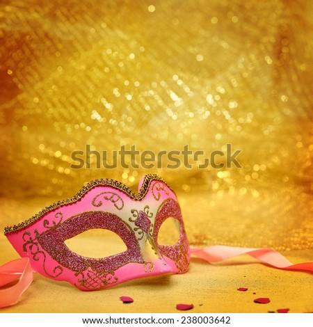 Vintage carnival mask in golden background - stock photo