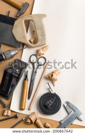 Vintage carpentry workplace. 'Still life' with old carpentry's tools. Vertical composition - stock photo