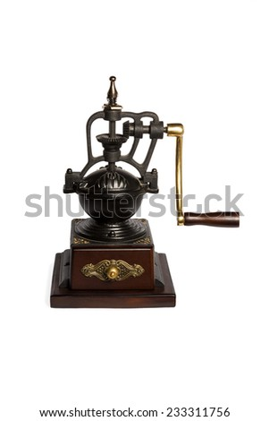 Vintage cast iron coffee grinder with wooden stand isolated on white background - stock photo