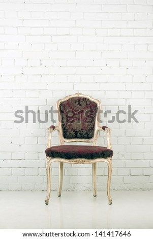 Vintage chair and brick wall with copy-space