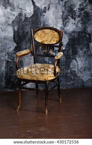 Vintage chair on the background of shabby wall