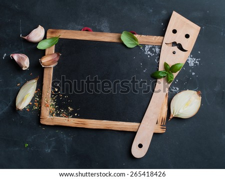Vintage chalk board with spatula and spice, selective focus.  Cooking concept  - stock photo