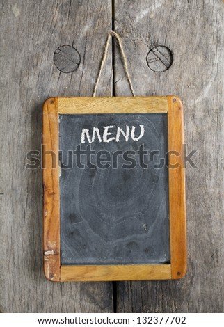 vintage chalkboard menu, free space for your copy, with old wooden background - stock photo