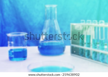 vintage chemistry experiment blur background - stock photo