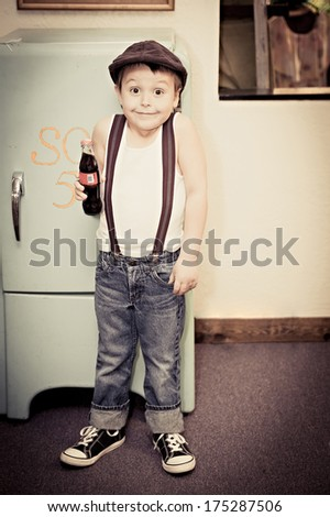 Vintage child with a soda - stock photo