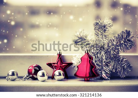 Vintage Christmas background with Christmas decoration against winter window - stock photo