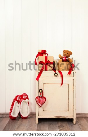 Vintage christmas background with presents and red and white decoration. - stock photo