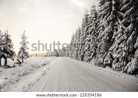 Vintage Christmas background with winter road and snowy fir trees  - stock photo