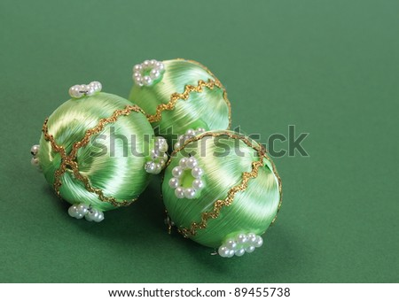 Vintage Christmas baubles on a green background