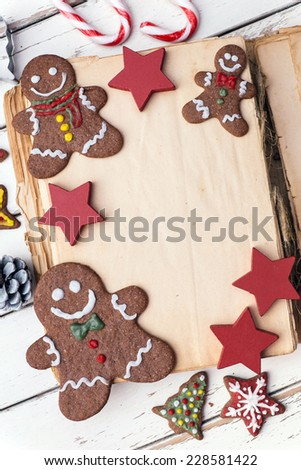 Vintage Christmas book with decoration and cookies - stock photo