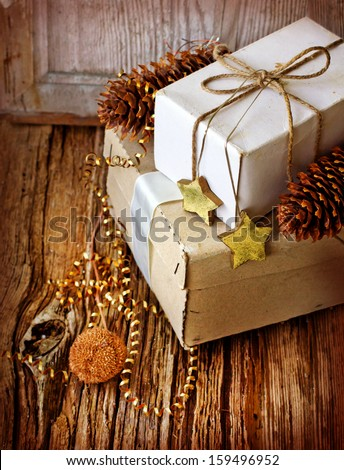 Vintage Christmas Card with Gifts, boxes, christmas decorations and christmas pinecones - stock photo