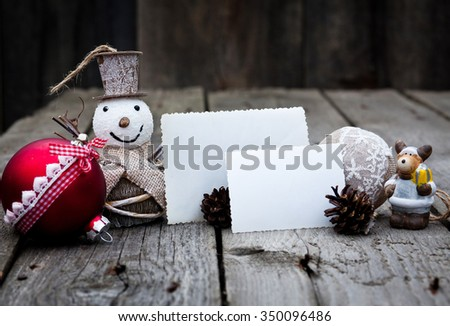 Vintage Christmas decorations and cards with copyspace on wooden background - stock photo