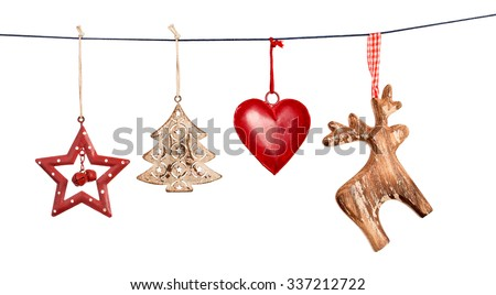 Vintage Christmas decorations hanging on string isolated on white background - stock photo