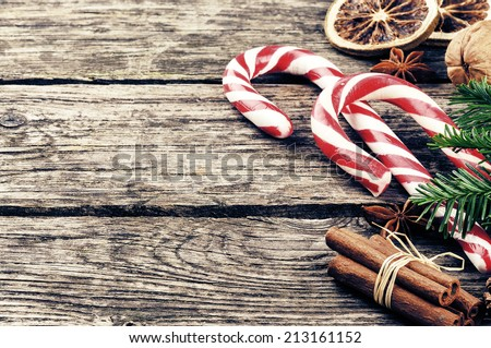 Vintage Christmas decorations with candy canes - stock photo