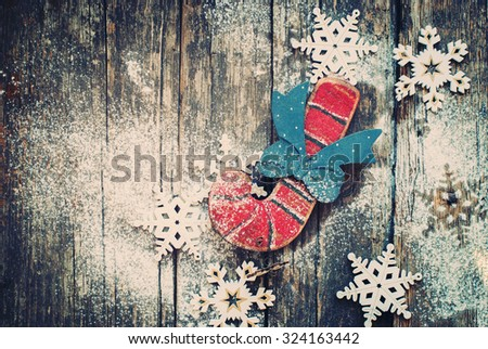 Vintage Christmas Fir Tree Toys Candy Cane and Snowflakes on Wooden Background. Horizontal image. Toned - stock photo