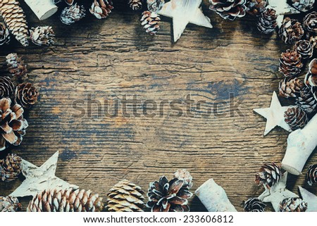 Vintage Christmas frame with cones and stars on wooden background - stock photo