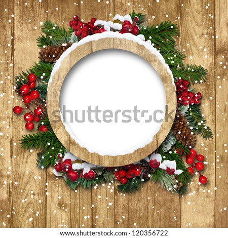 Vintage Christmas frame with decorations on a wooden background - stock photo