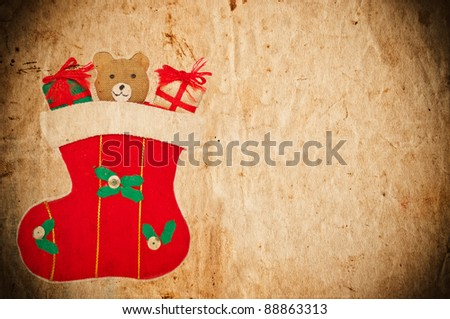 Vintage Christmas postcard with Christmas sock and teddy bear - stock photo