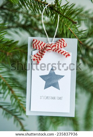 Vintage Christmas tag with ribbon and typewriter MERRY CHRISTMAS AND HAPPY NEW YEAR - stock photo