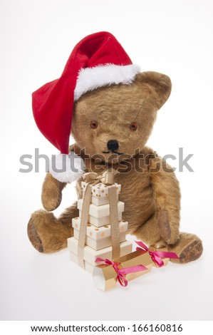 vintage Christmas teddy bear with presents isolated on white background