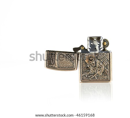 Vintage cigarette lighter isolated on white - stock photo