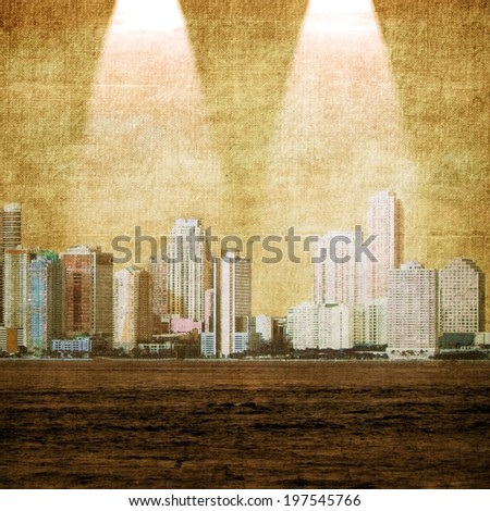 Vintage city skyline with two lights from above - stock photo