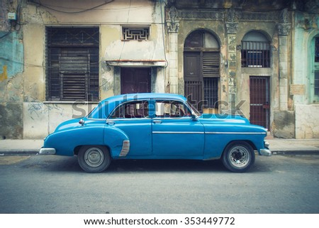 Vintage classic american car parked in a street of Old Havana - stock photo