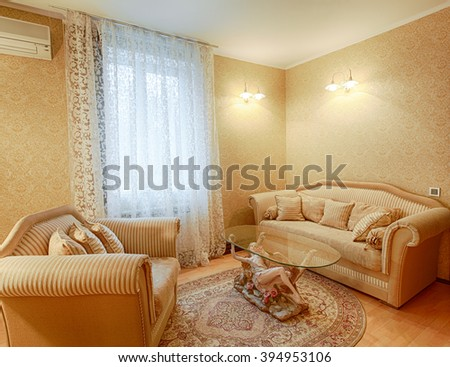 Vintage classic hotel room interior. Luxurious hotel suite premium interior design. Vintage bedroom, elegant and luxurious. Hotel classic interior. Sofa, table, double bed with canopy. - stock photo