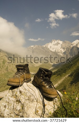 Vintage climber boots are dried in the base camp in mountains - stock photo