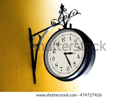 Vintage Clock on a Yellow Wall / Daylight Saving Time