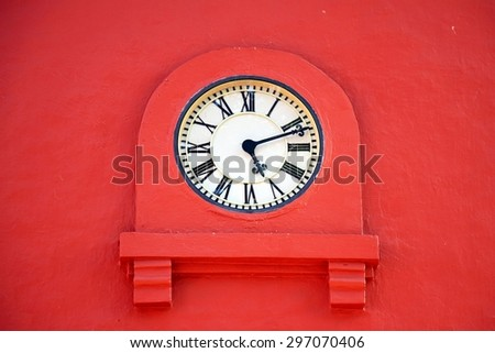 Vintage clock on an old stucco wall. Tower clock. - stock photo