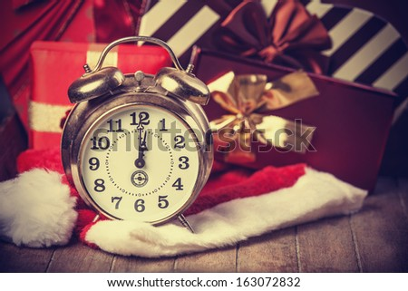 Vintage clock on christmas background - stock photo