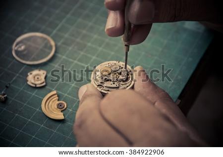 Vintage Clock Repair,selective focus - stock photo