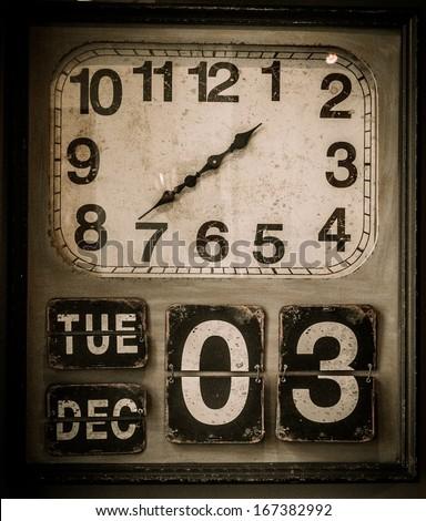 Vintage clock with a calendar  - stock photo