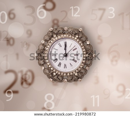 Vintage clock with numbers comming out on the side - stock photo
