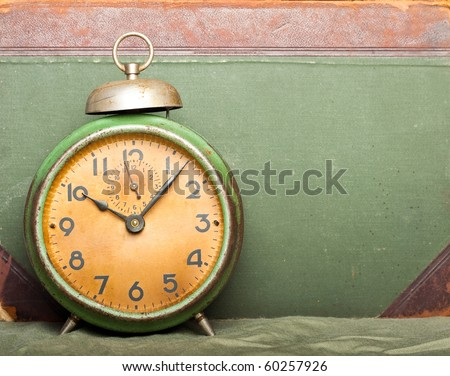 vintage clock with old book on background - stock photo