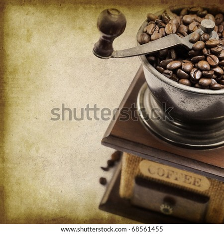 Vintage coffee grinder with coffee beans - stock photo