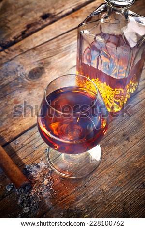 Vintage cognac still life on wooden background - stock photo