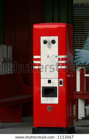 Vintage coin operated drink machine - stock photo