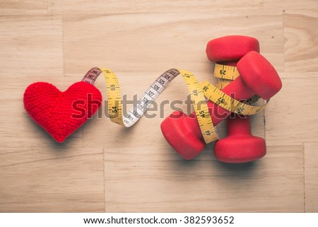 Vintage color of healthy heart concept. Sport equipment. Different tools for sport on wooden background - stock photo