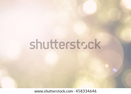 Vintage color tone blurred nature background of a view looking up through foliage of tree against the sky facing sun flare and bokeh: Blurry natural greenery wood view in cyan green blue color tone - stock photo