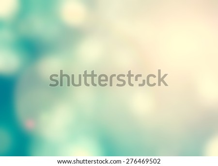 Vintage color tone blurred nature background of a view looking up through the foliage of a tree against the sky facing sun flare - stock photo