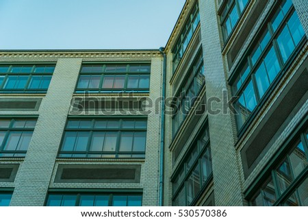 vintage colored brick building in low angle view
