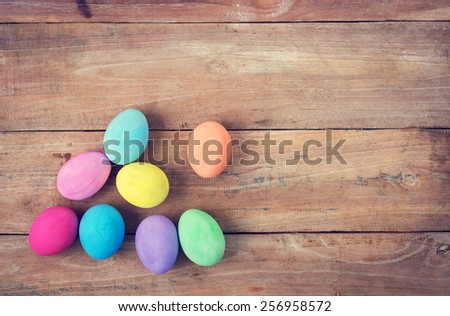 Vintage colorful easter eggs on wood table background - stock photo