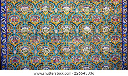Vintage colorful floral pattern and oriental ornament on the ceramic tiles of the old royal palace in Iran - stock photo