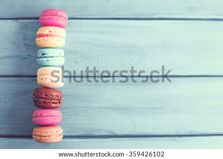 Vintage colorful macarons over turquoise wood - stock photo