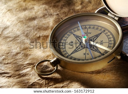 Vintage compass on paper background - stock photo